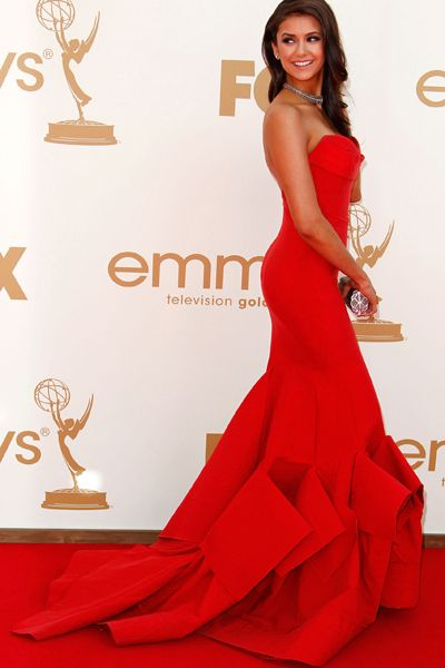 Wear a designer red carpet gown....this is beautiful and she can pull off the bulky train!! 'Cherie