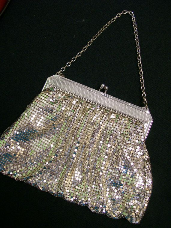 """mint condition silver metal mesh purse from Whiting and Davis, 1920s, brilliantly shining and completely intact, kiss lock, original chain, ivory satin lining with light age staining and a red lipstick stain on bottom of lining, truly exceptional outside, frame 4 3/4"""" across, 7"""" across at base, 4 1/4"""" high body, 4 3/4"""" height to top of frame, 10"""" chain"""