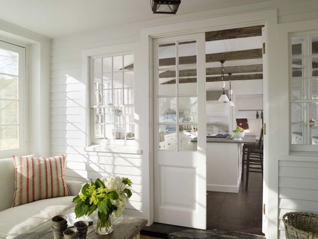 Sunroom pocket door to kitchen white walls exposed for Kitchen with sunroom attached