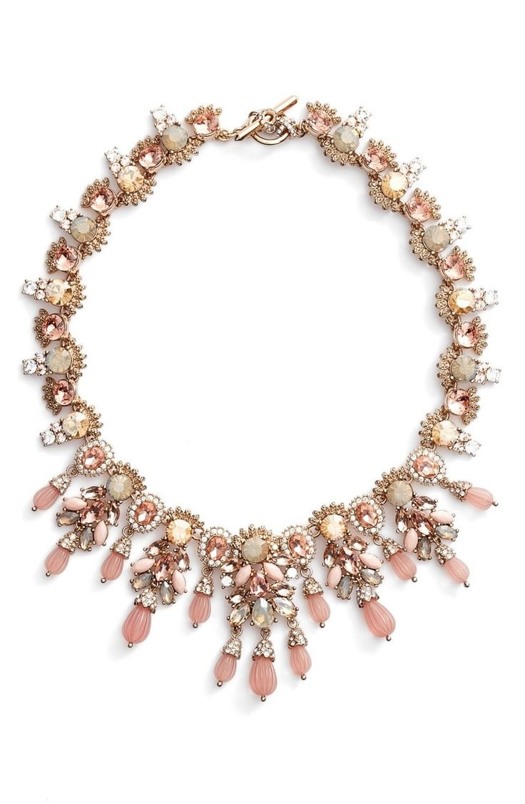 When the occasion calls for all-out glamour, reach for this spectacular collar necklace made with dazzling sprays of shimmering jewels, crystals and beads.
