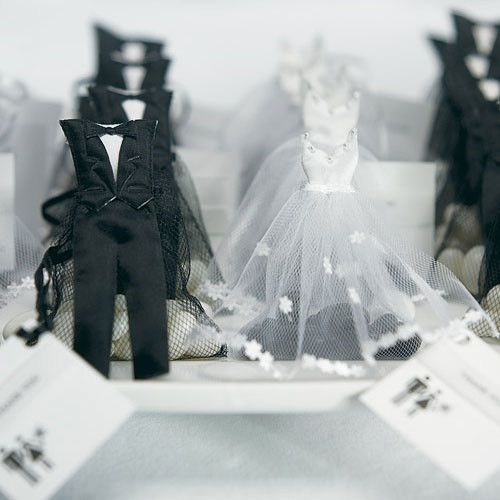 "These adorable Bride Dress and Groom Tux Favor Bags make an exceptional Favor ""Couple"". In classic Black and White, they will complement any wedding color scheme. Shown here filled with white and blac"