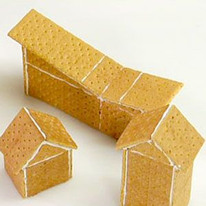 So creative, affordable and EASY- Graham Cracker Gingerbread Houses or Nativity Scene.  Use  Marshmallow/Icing to hold together and for snow then add colorful gumdrops and candies.