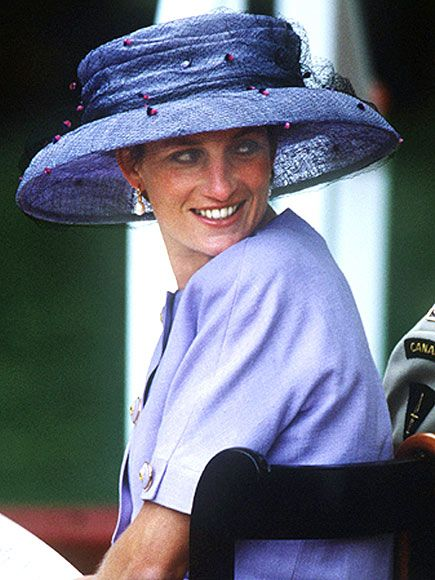 SHADE OF PURPLEDiana wore an oversized hat by Philip Somerville to the June 1994 Canadian memorial dedication in Green Park, London.