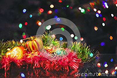 Christmas New Year's toys on a blurred background of Christmas trees and garlands.