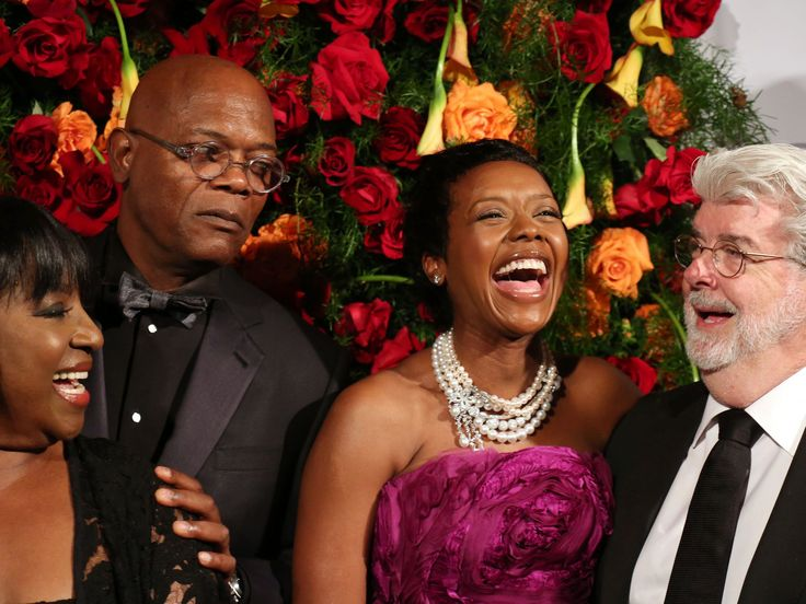 Samuel L. Jackson must have missed the joke as his wife, LaTanya Richardson, left, Mellody Hobson and her hubby, George Lucas, right, share a laugh at the American Theatre Wing event to honor James Earl Jones at the Plaza Hotel on Monday in New York.  Walter McBride, WireImage