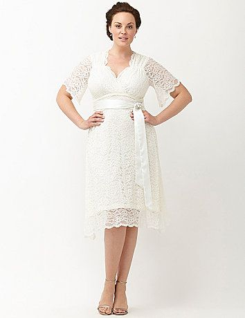 Channel the glamour of old Hollywood on your special day with Kiyonna's Lace Confections Wedding Dress. This beautiful dress embodies retro style with a flattering empire waist and A-line skirt that flows away from the body to create a fantastic shape. You will love the simple detailing of the removable satin sash and rhinestone and pearl encrusted brooch. lanebryant.com