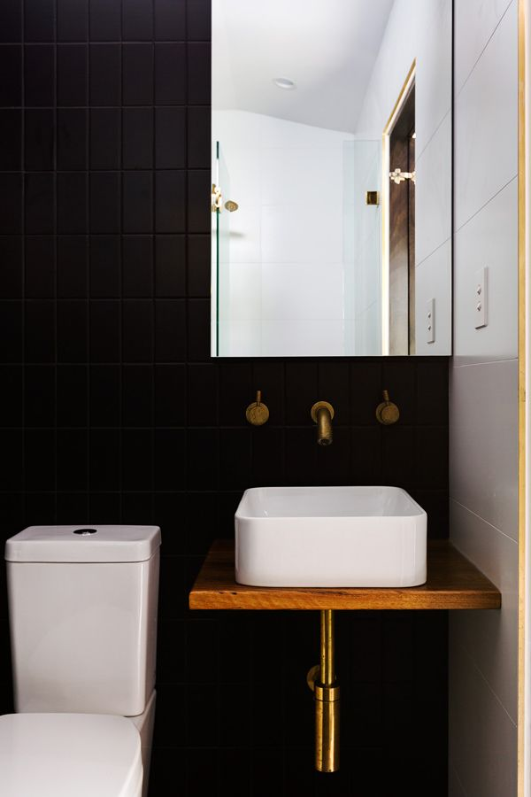 black and brass bathroom by the designer Pip Norris
