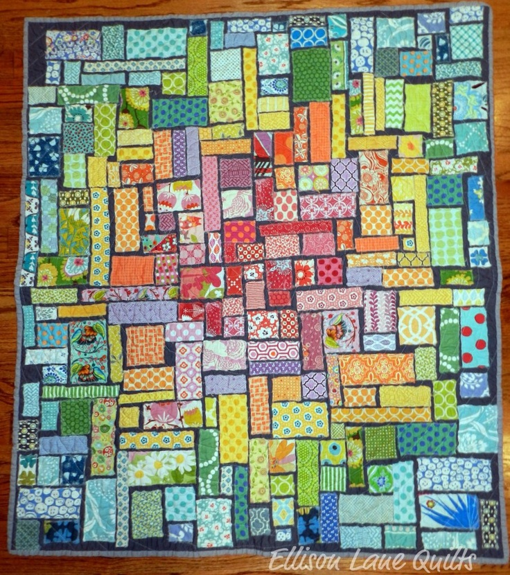 Ticker Tape Quilt ....to use up those little scraps.