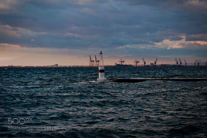 Thessaloniki harbor http://ift.tt/1PwaAJe Lighthousebeachbluecloudsoceanseaseascapeskysunsettravelwaterwaves