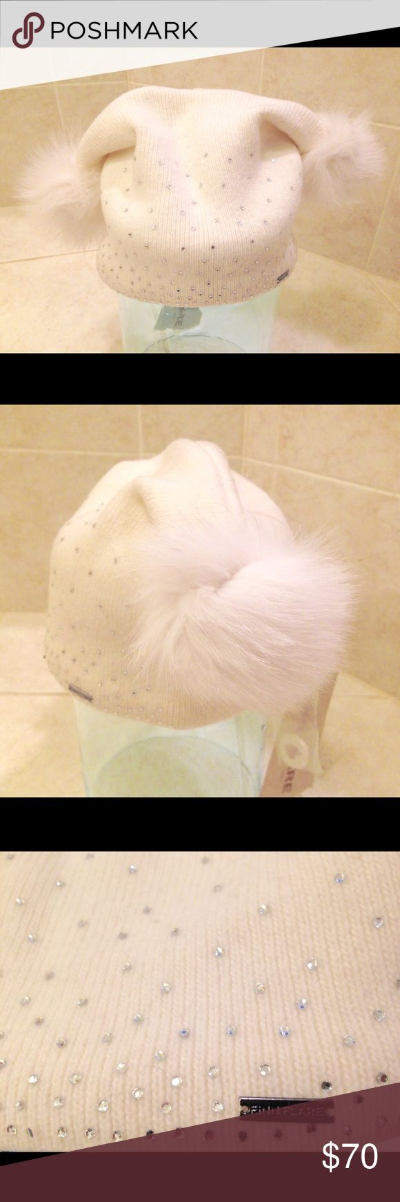 Modern winter hat Gorgeous Russian winter hat with crystals and real polar fox fur. Brand Finn Flare. Very soft and worn, perfect for winter! 38% wool, 32% polyamide, 30% angora. Lining 100% polyester. Decorated with crystals and polar fox fur. Made is Russia. Condition new with a tag Accessories Hats