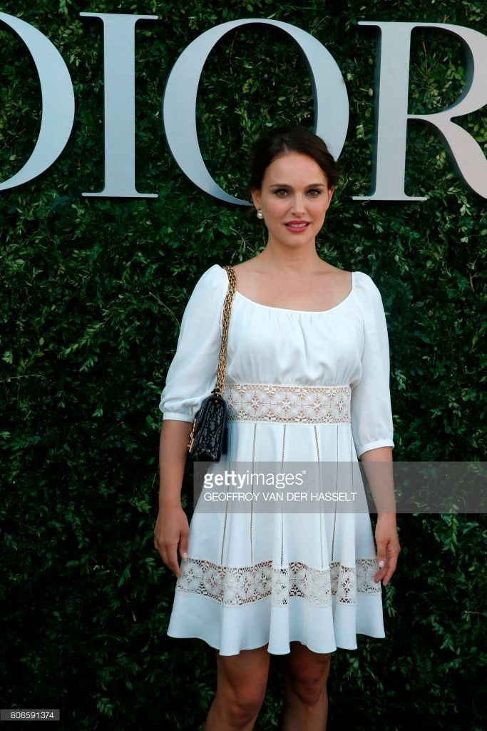 US and Israeli actress Natalie Portman poses as she arrives for the opening of the Dior exhibition that celebrates the seventieth anniversary of the Christian Dior fashion house on July 3, 2017 in Paris. The exhibition at the Museum of Decorative Arts (Musee des Arts Decoratifs) is a retrospective presenting some 400 dresses, and runs through July 5, 2017 - January 7, 2018. /