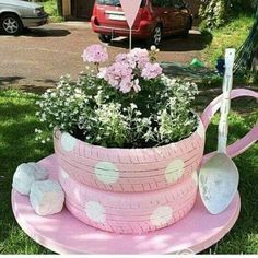 """Recycled Tire Tea Cup & Saucer - Comments: """"It looks like they used lawn edging for the handle, the old wooden spoon from the fork and spoon set used year's ago on the wall at your grandparents house . The sugar cubes are Bricks and the dish looks like a satellite dish, the tires look small like 13 inch or maybe riding lawn mower tires."""" """"You have to cut down the tire along the tread for the planter. use the cut out part for the cup handle, I think it will work."""""""