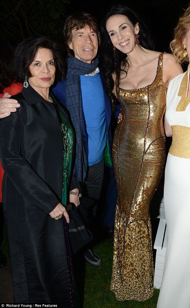 Friendly terms: Sir Mick Jagger with ex-wife Bianca (left) and current girlfriend L'Wren Scott at the Serpentine Summer Party in London