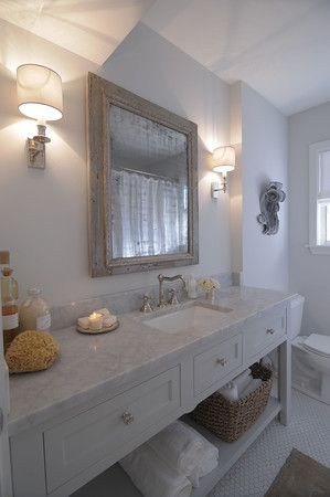 bathroom renovation - custom cabinet with open lower shelf, carrara marble counter tops, polished nickel fixture and sconces. luxe living interiors