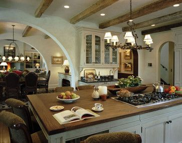 Brodbeck rustic kitchen. Yes!! The wide arches and open layout! Perfect. I would have a better chandelier that's all I would change.