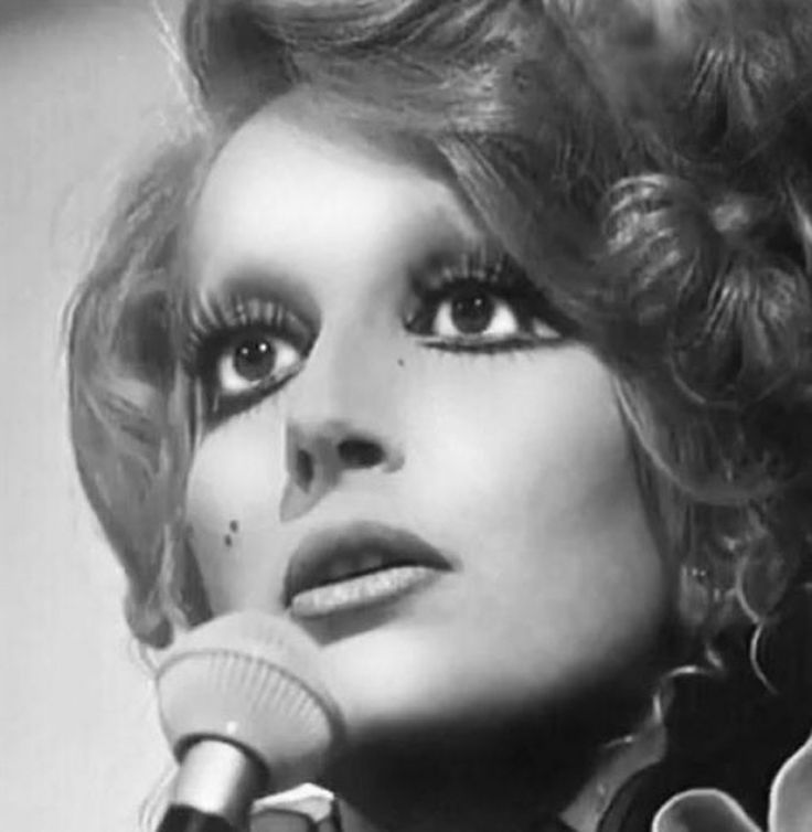 Mina - I love her music! It's forever timeless and her voice is incredible