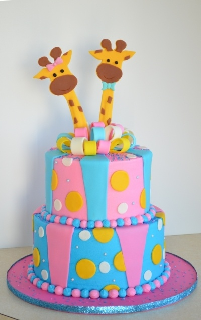 Boy And Girl Giraffe for twin baby shower. or great cake for a reveal party just put the color of the baby inside. (blue or pink)