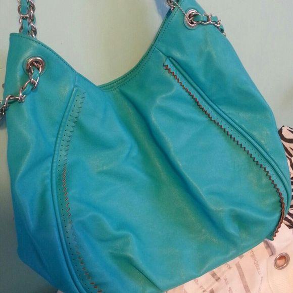 Big Buddha purse This is a large teal handbag. Very roomy, and very stylish. Big Buddha Bags Satchels