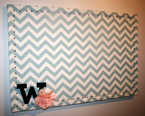 Fabric covered cork board with nail head trim. MUST MAKE!