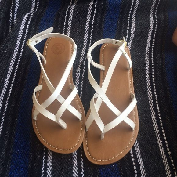 White strappy sandals Super cute white strappy sandals! Great for spring and summer seasons. Goes with so many different outfits! Can dress up or down. Never worn, only tried on! In excellent condition! SO Shoes Sandals
