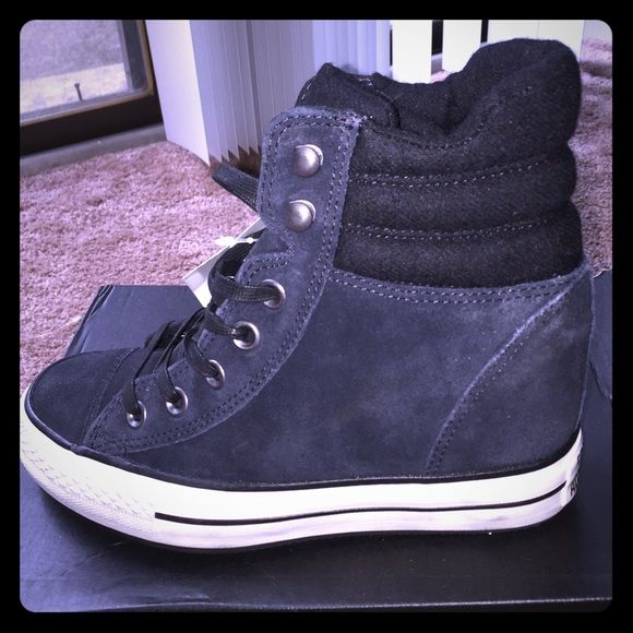 Converse Hidden Wedge Sneakers Black suede, hidden wedge sneakers. Never worn. The discoloration on the bottom is from the suede. They were like that in box. Super cute! Having wide feet Converse Shoes Wedges