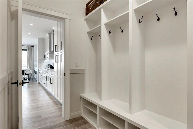 Mudroom The Kitchen Opens To A Mudroom With Custom Cubbies And Wainscoting Mudroom Cubbies Mudroomcubbies Wainscoti Mudroom Beautiful Homes Mudroom Cubbies
