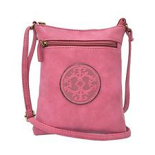 This solid color fuchsia Mini Faux Leather Sling Bag with a large Chateau Emblem on the front measures 7.5 inches Tall x 5.5 inches Wide with a top zip closure.  This shoulder bag features a soft faux leather with a Suede Like Feel and a front zippered pocket for easy access to things that you need at your fingertips.