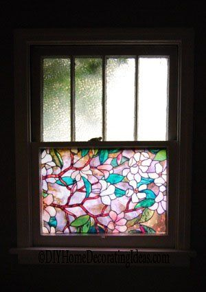 Stained glass window film for privacy. Does strip off easily. Great if you rent.