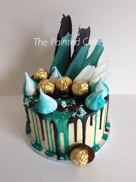 Black, Teal and white drip and chocolate brushstrokes! #brushstroke #chocolatedripcake #dripcake #portpower #meringuekiss #cakesofadelaide #thepaintedcakeaus