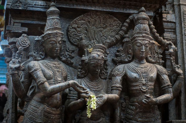 https://flic.kr/p/9DURrw | Madurai Meenakshi amman temple | the sculpture represents wedding of Lord Shiva and Parvathi. Lord Vishnu, brother of Goddess Parvathi is in the middle.