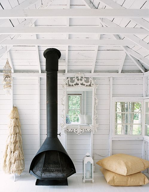 Black fireplace against white walls