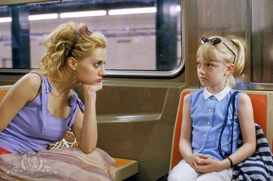 Still of <a href='/name/nm0005261/?ref_=m_ttmi_mi_tt'>Brittany Murphy</a> and <a href='/name/nm0266824/?ref_=m_ttmi_mi_tt'>Dakota Fanning</a> in <a href='/title/tt0263757/?ref_=m_ttmi_mi_tt'>Uptown Girls</a> (2003)
