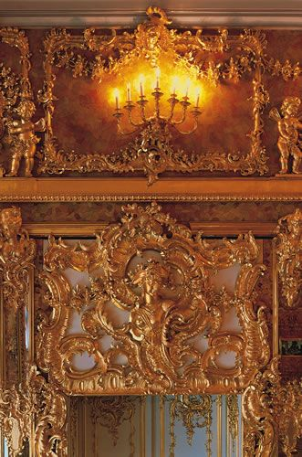 The Amber Room in the Catherine Palace of Tsarskoye Selo near Saint Petersburg is a complete chamber decoration of amber panels backed with gold leaf and mirrors.