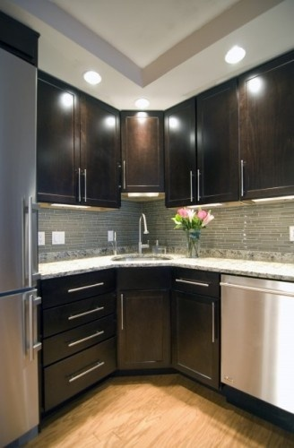 Dark Cabinets, Light floor and light counter tops... You can also bring lightness to the room by picking a light colored backsplash to POP with the light granite and dark cabinets. Then the stainless steel will be AWESOME!