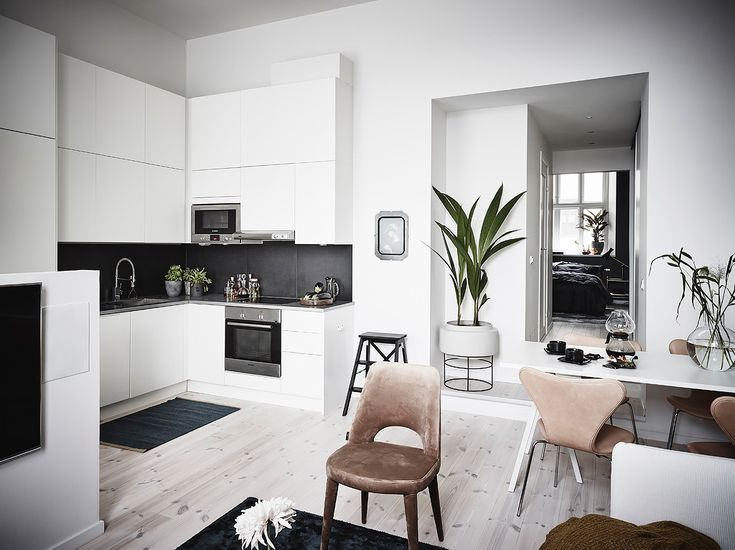 Gravity Home: Kitchen in a Small Apartment with Dark Bedroom