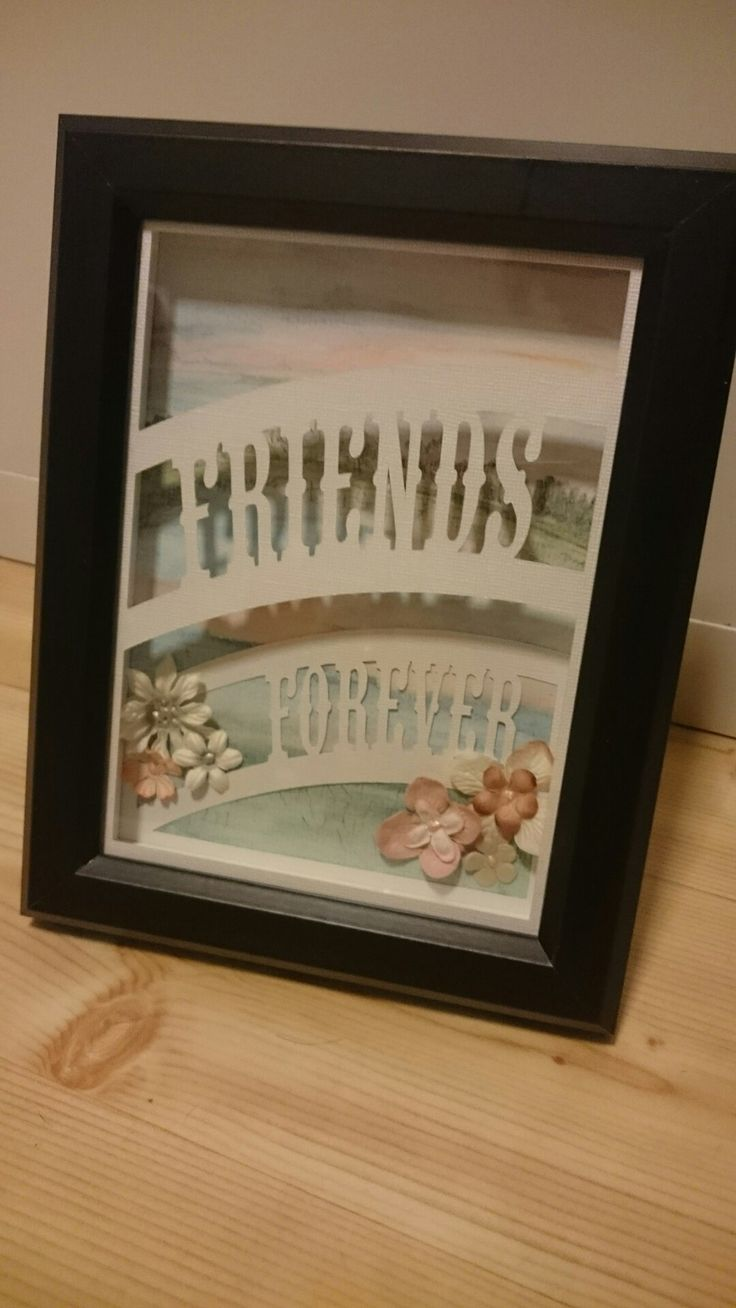 Watercolor painting in the background, paperflowers and text in a 3D frame from Ikea. Text cut by Silhouette machine.