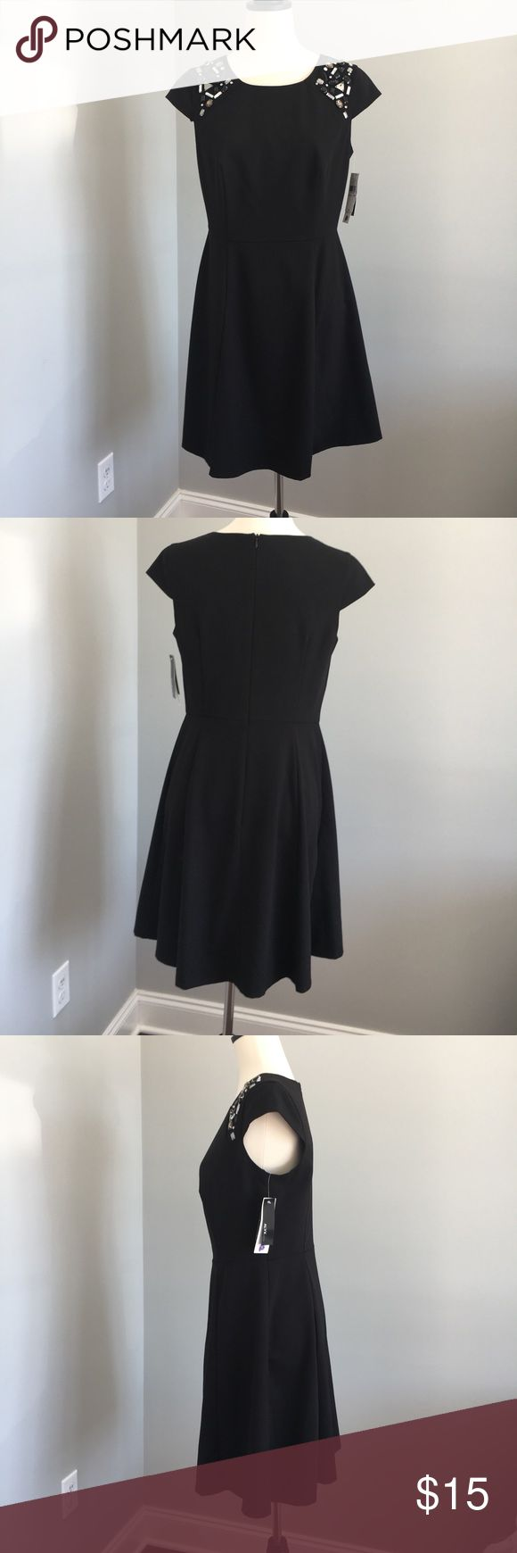 ALYX Cap-Sleeve Petite Black Dress Jewel Accents NWT. ALYX petite black dress has cap sleeves with jewels. Zipper in back. Dress is lined only around the to section of the dress.  63% Polyester 33% Rayon 4% Spandex, lining is 100% Polyester.  Do not dry clean. Hand wash cold and line dry. Alyx Dresses