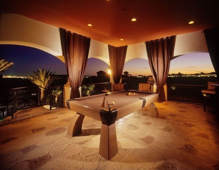 Mediterranean Game Room with can lights, Outdoor curtain, Columns, slate floors, Arched doorway, Balcony, quartz floors