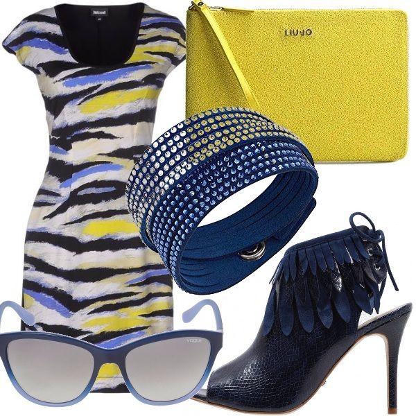 Per eccellenza il giallo, colore del sole, e il blu, color del mare simboleggiano l'estate. In un elegante tubino multicolore con abbinamenti di blu e giallo la donna è pronta per uscire in ogni occasione.