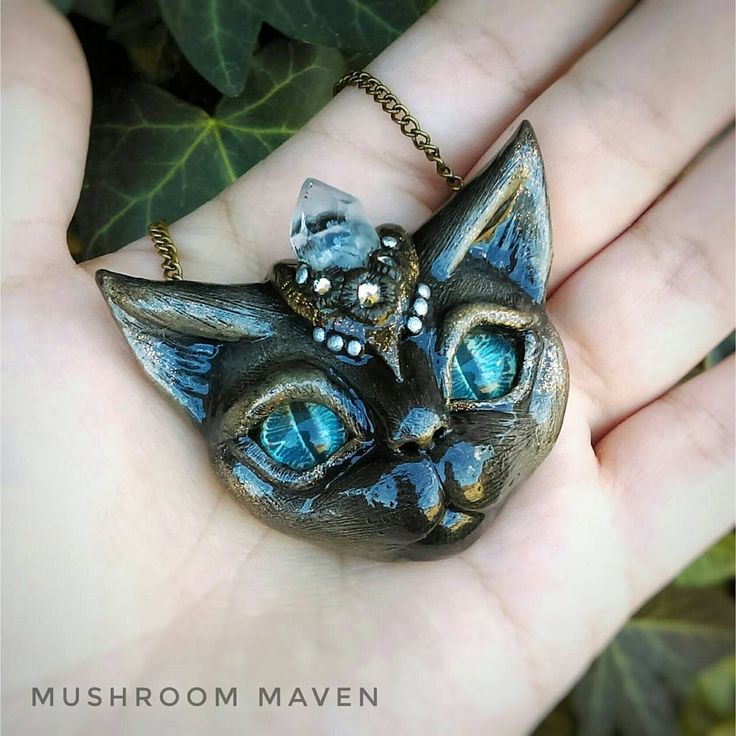 Polymer clay cat head pendant with crystals and glass eyes