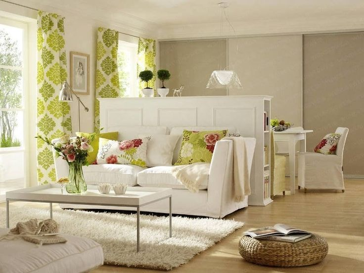 Living Room Decorating Ideas on a Budget - great small space decor idea (the half wall)... I like!