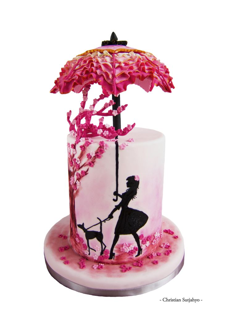 Pink Umbrella Inspiration Challenge - Inspired by ruffles and cherry blossom hues, this cake uses hand painting and sponge dusting techniques. Gum paste was used for the umbrella ruffles as well as the tree branches.