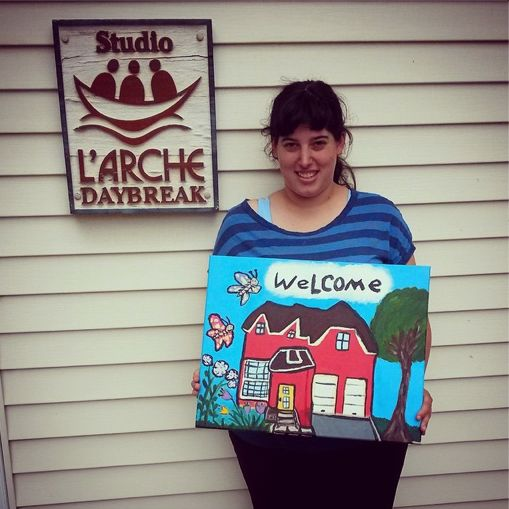 Courtney from L'Arche Daybreak, with her newest painting: Welcome to the Red House #art #community #welcome