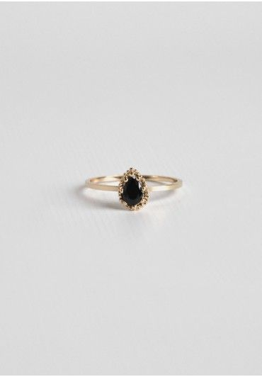<p>Delicate and elegant, this simple gold-toned ring is adorned with a black teardrop-shaped jewel. Style this gorgeous ring with other dainty jewelry for a chic touch.</p> <p>All rings are a size 7.5</p>