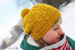 Fuego Hat is a seamless slouchy or beanie worked from bottom to top. It features unique cables resembling flames. The cables correspond to the ones present on Fuego Cowl.