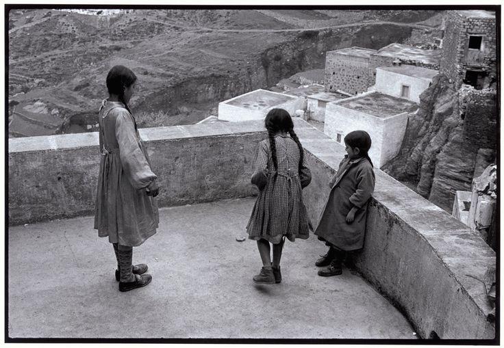 """Constantine Manos View profile Greece. Karpathos. Olympos. 1964. Hopscotch on a rooftop. """"A Greek Portfolio"""" p.9 © Costa Manos/Magnum Photos"""