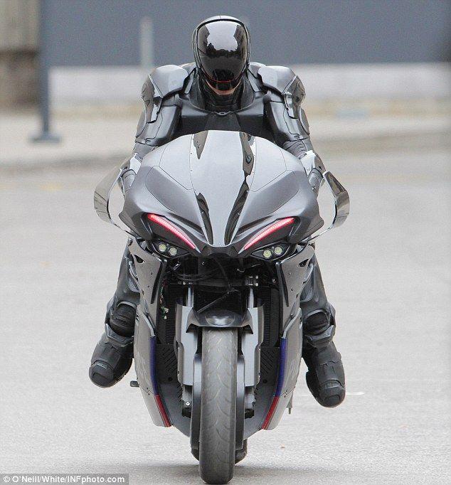 Power: Joel Kinnaman rides a futuristic motorbike on the set of Robcop remake in Toronto on Saturday October 13