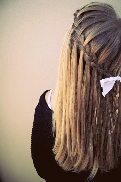 Long hair + blonde + waterfall braid + bow