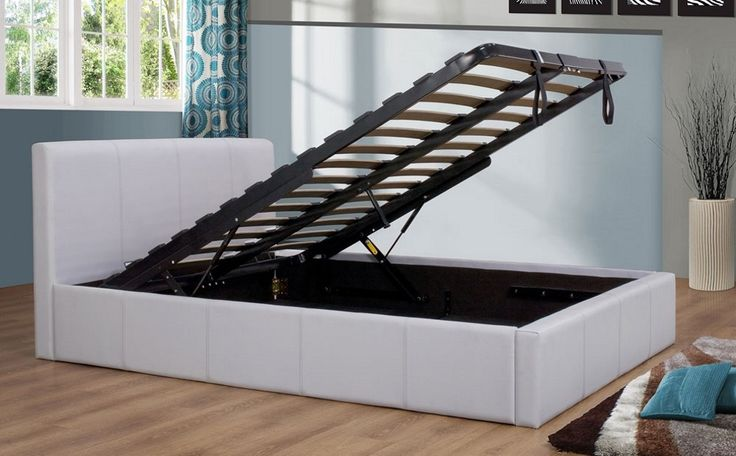 4ft Ottoman Bed Frame - WHITE - £299.95 - Features a sprung slatted base for improved comfort, a soft and realistic faux leather and a massive storage area underneath which is accessed by lifting the bed base. The hinge mechanism uses excellent quality German made gas struts which offer an assisted lift making it easy to raise and lower.