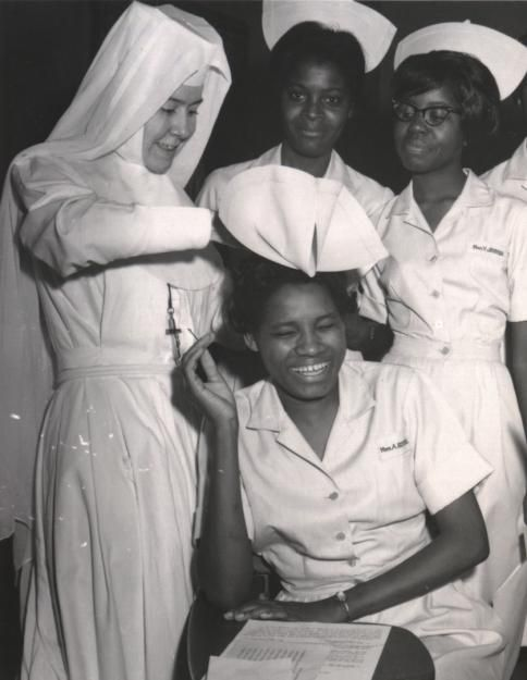"Sr. Barbara Lum taught nurses in the Selma, Ala.-based Good Samaritan Hospital, which was the only one to serve black people in a nine-county region during the Jim Crow days in America's South. Here she ""caps"" recent graduates of the licensed practical nursing program. (Photo courtesy of Sisters of Saint Joseph of Rochester archives)"